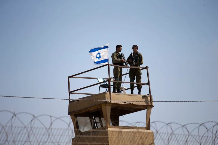Israeli soldiers guard on top of a watch tower in a community along the Israel- Gaza Strip Border. (File photo: AP)
