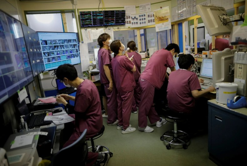 Medical workers wear protective face masks as they work at the ICU ward for coronavirus patients at St. Marianna Medical University Hospital in Kawasaki, south of Tokyo, on May 4, 2020. (Reuters)