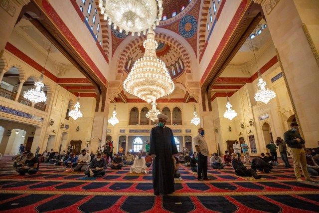 Muslim worshippers wearing masks offer Friday prayers while maintaining a social distance at the Mohammad al-Amin Mosque in Beirut on May 8, 2020. (AP)