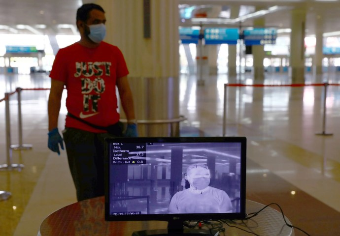 A man is seen through a thermal camera at Dubai International Airport amid the outbreak of the coronavirus in Dubai, UAE, April 27, 2020. (Reuters)