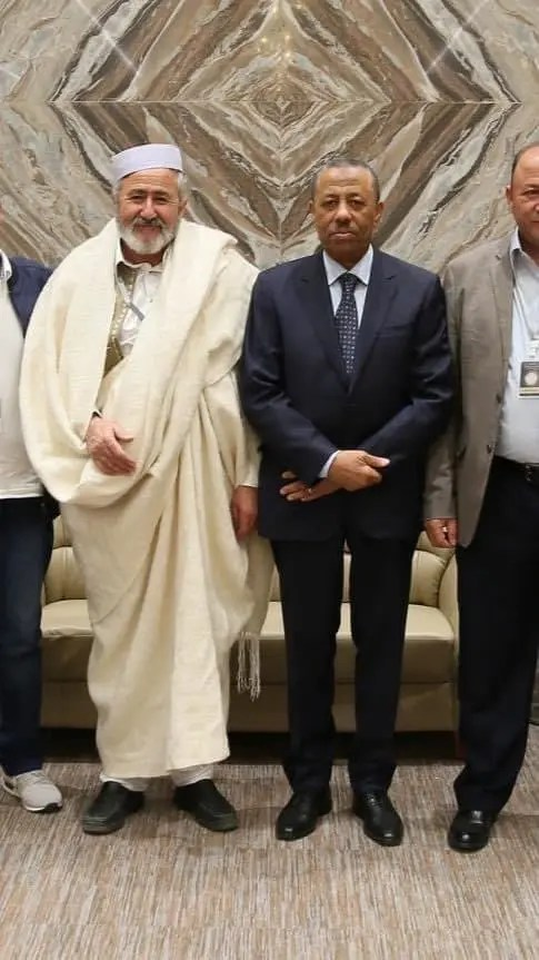 Makhlouf with the head of the interim government Abdullah Al-Thani