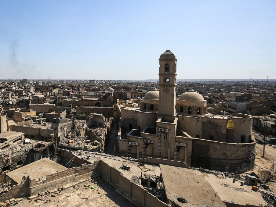 A picture taken on March 14, 2018 shows a view of destruction surrounding the Roman Catholic Church of Our Lady of the Hour in the old city of Mosul, eight months after it was retaken by Iraqi government forces from the control of ISIS. (AFP)