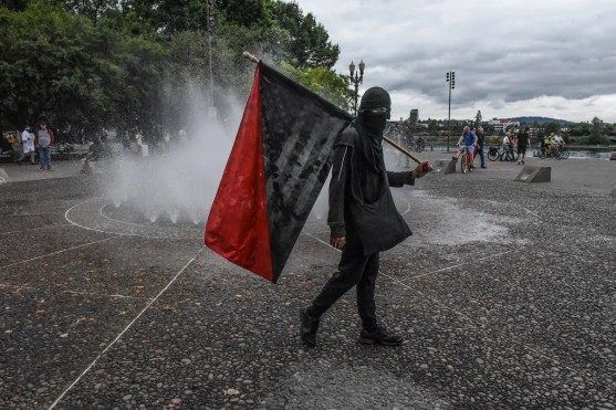 Members of Antifa pass a fountain during an alt-right rally on August 17, 2019 in Portland, Oregon. (File photo: AFP)