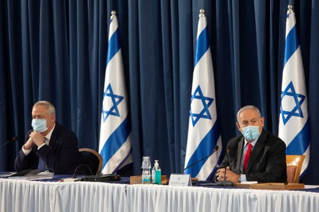 Netanyahu and Gantz attend the weekly cabinet meeting in Jerusalem, June 14, 2020. (Reuters)