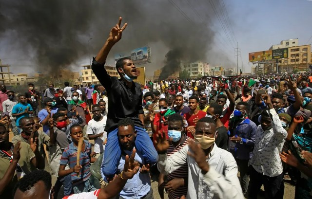 Sudanese demonstrators gesture as they chant during a protest on Sixty street in the east of the capital Khartoum, on June 30, 2020. (AFP)