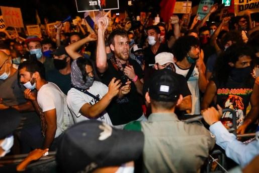 Israelis protest against Netanyahu outside his official residence in Jerusalem, July 14, 2020. (AFP)