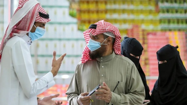 A man displays his details on his mobile phone using the Tawakkalna app, which was launched by Saudi authorities to track people infected with the coronavirus disease (COVID-19). (Reuters)