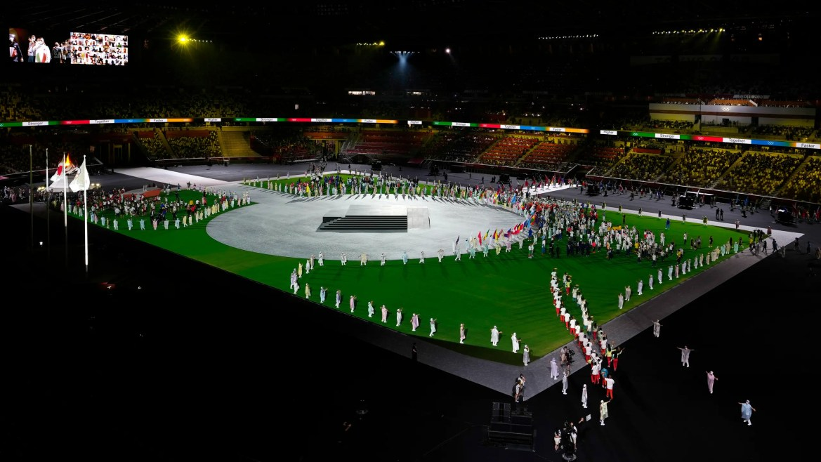 Athletes enter the stadium during the closing ceremony in the Olympic Stadium at the 2020 Summer Olympics, Sunday, Aug. 8, 2021, in Tokyo, Japan. (AP)