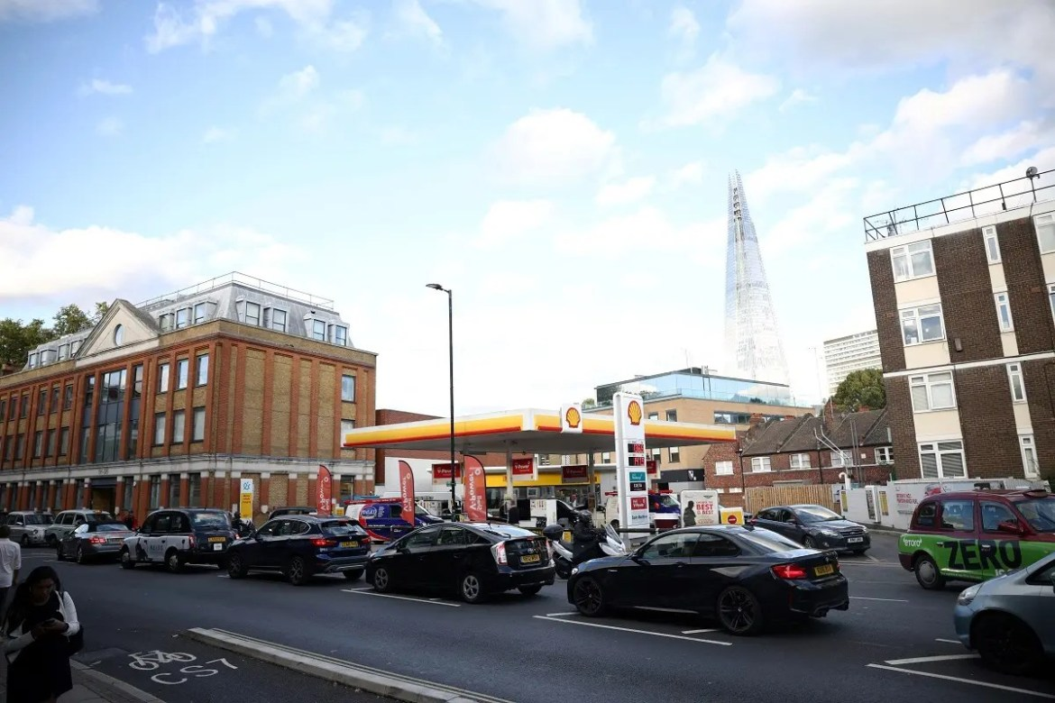 Vehicles queue to refill at a Shell fuel station in central London, Sept. 27, 2021. (Reuters)