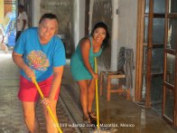 Sweeping and mopping the salón