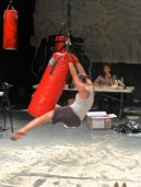 Using a boxing bag as a pole for dancing