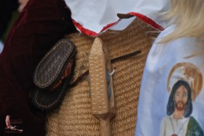 A rectangular wooden tambourine
