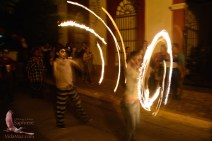 Spinning fire dancers