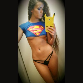 Joanie Brosas super man with pikachu phone