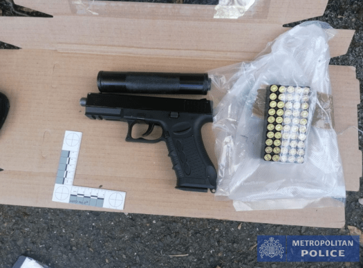 A gun and ammo recovered by the Met Police