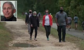 Dr. Fauci and his wife are flanked by bodyguards while out walking after he receives death threats for coronavirus warnings