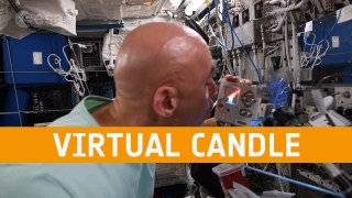 Luca Parmitano blows out his virtual candle on the Astro Pi