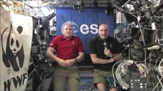 ESA astronaut André Kuipers and astronaut Don Pettit greet WWF