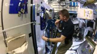Tim Peake brushing his teeth in space