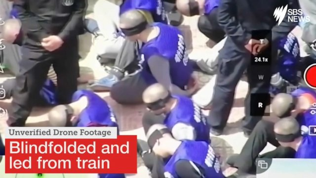 Image result for Disturbing video shows hundreds of blindfolded prisoners in Xinjiang