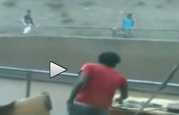 WHOA! Dude Gets Knocked Out and Tossed Into Traffic