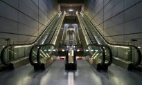 Woman Dies When Her Scarf Gets Caught in an Escalator