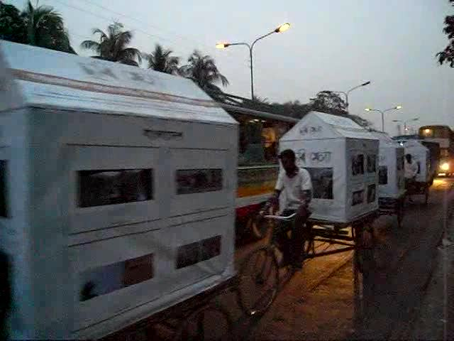 CMV mobile exhibit on richshaw vans head back to Drik in the eve