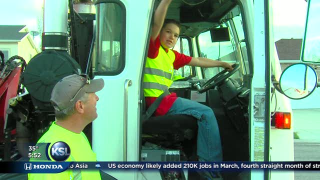 Garbage truck driver makes time for 11yearold boy wins