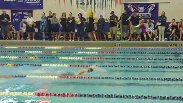 Woodland's Dia Gawronski in action at state swim meet