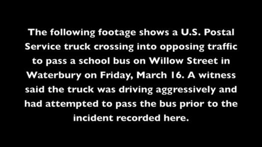 A U.S. Postal truck passes a school bus in Waterbury