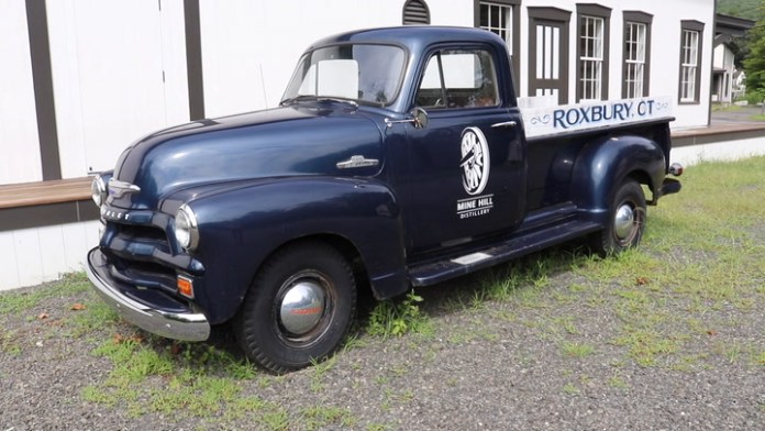 Elliott Davis of Washington, Conn. owns a non-running 1955 Chevrolet 3600 pickup that currently serves as a promotional vehicle for the new Mine Hill Distillery by sitting in front of the facility in nearby Roxbury.