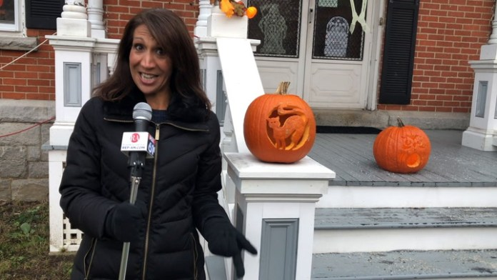 Community Karen visits Dowtown is A-Glow in Torrington for the Halloween festivities. Check out all the jack-o-lanterns carved by children at St. John Paul the Great Academy that lined the streets.
