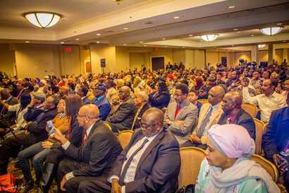 Members of the Sudanese diaspora listen to Sudan's Prime Minister Abdalla Hamdok as he addresses them at a Washington hotel. (Twitter - @SudanPMHamdok)