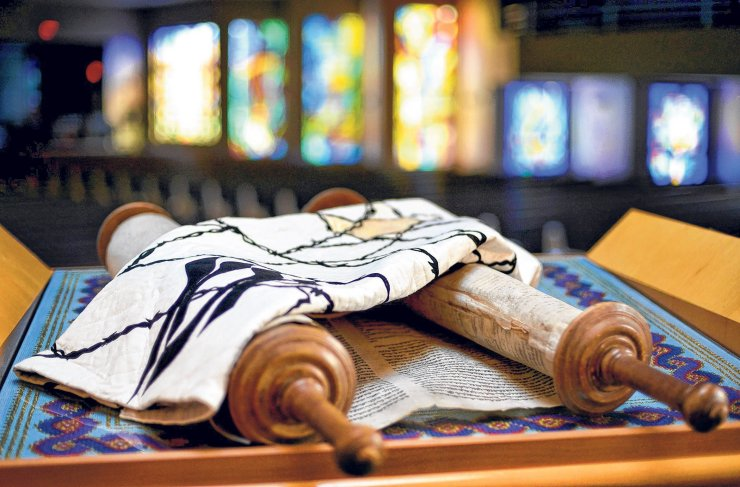 """092012 PBDN Jeffrey Langlois 1 of 1 Judaic artist Jeanette Kuvin Oren designed the cover that will be used on Temple Emanu-El's Torah that was rescued from Germany during WWII. The cover has the Hebrew word """"Yizkor"""" sewn on it, which means """"we will remember."""""""