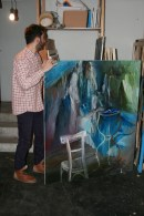 Nazim Unal Yilmaz with his painting