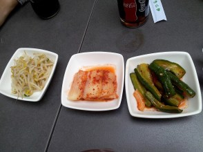 The kimchi in the middle alongside with other vegetables