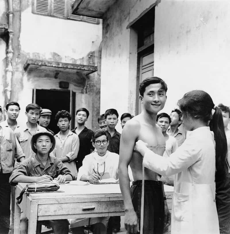 uly 1967 New recruits undergo physical examinations in Haiphong. The North's volunteer system was transformed into a mandatory system in 1973, when all able-bodied males were drafted. From a corps of around 35,000 men in 1950, the NVA grew to over half a million men by the mid-'70s, a force the U.S. military conceded was one of the finest in the world. IMAGE: BAO HANH/ANOTHER VIETNAM/NATIONAL GEOGRAPHIC BOOKS