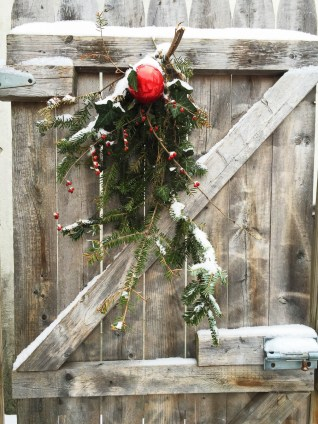 Natural Christmas decoration on a wooden door