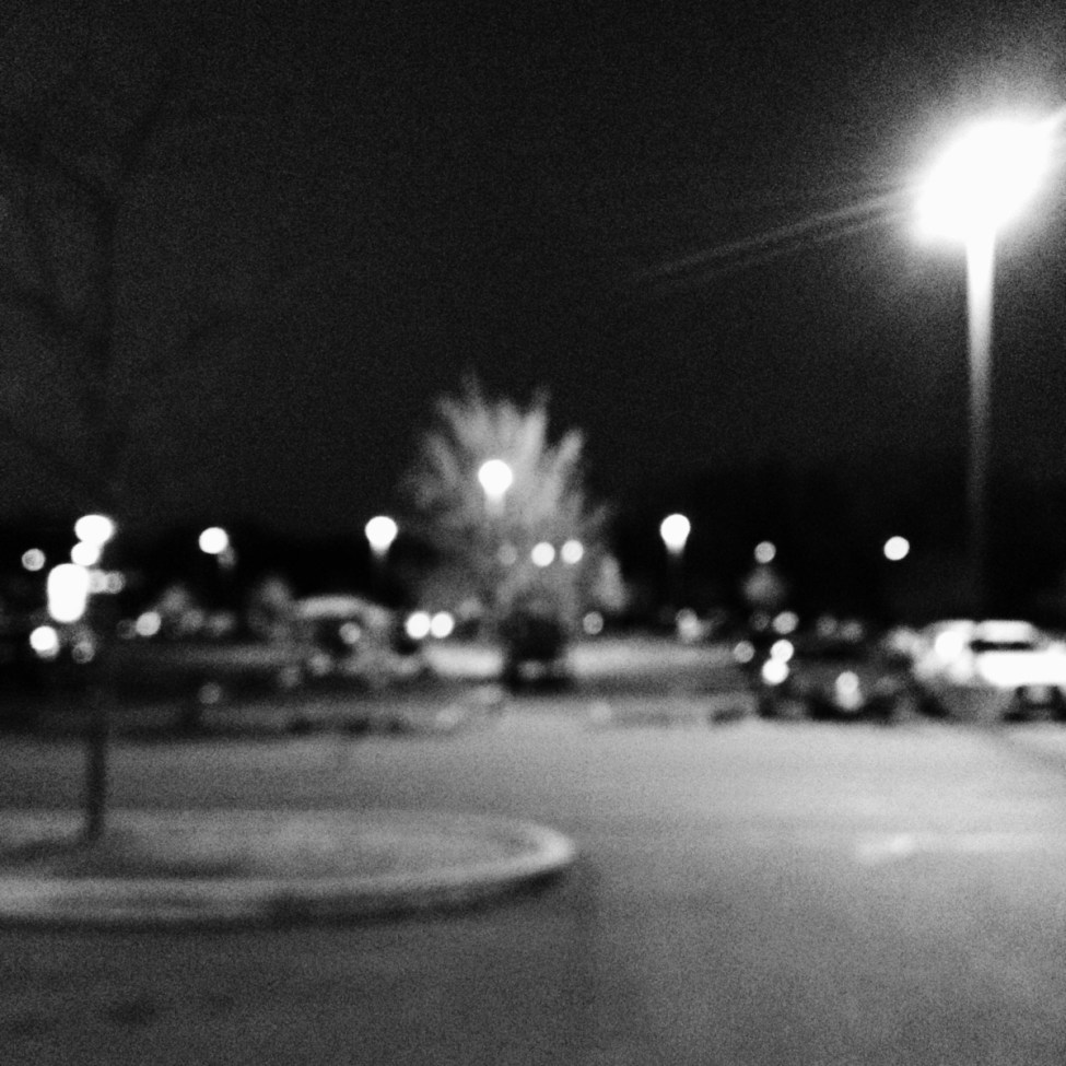 Parking lot at night by Nikki Gardner