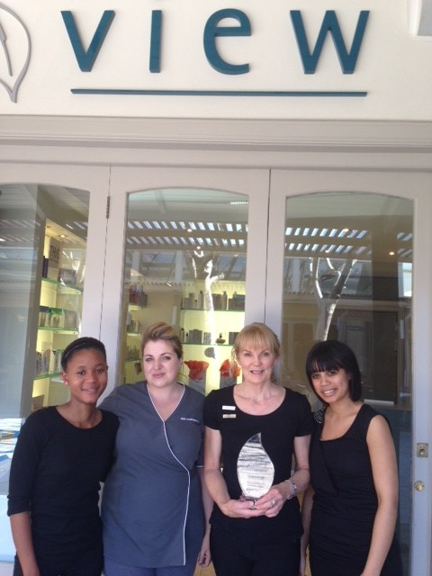 View health and skin care clinic staff members with Award