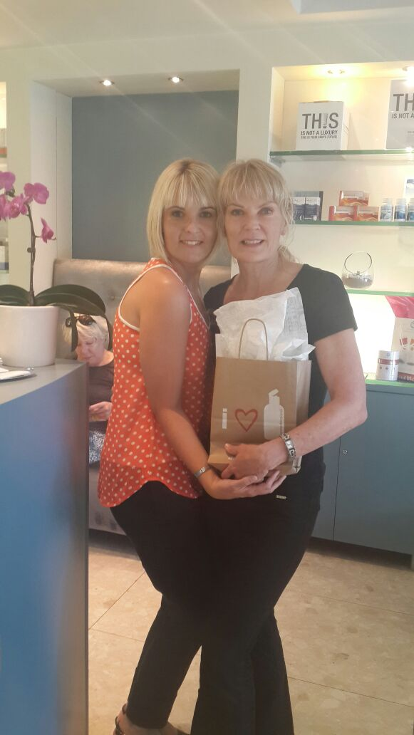 Marijke the owner of View health and skin care clinic receiving the Gold PSP award and gift from Dermalogica
