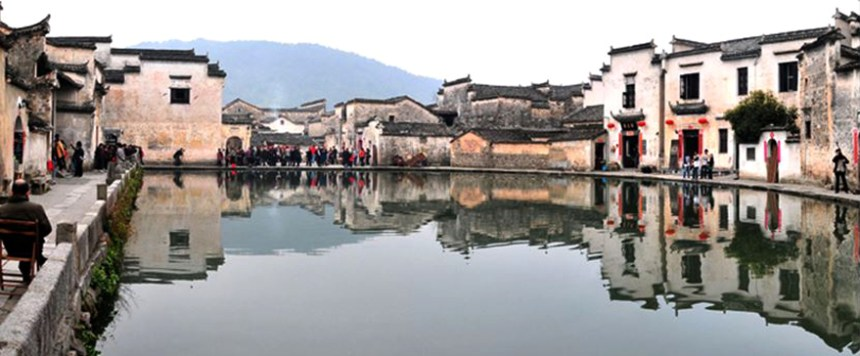 The half-moon pond in the centre of the mountain village Hongcun