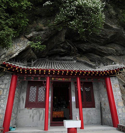 A small temple under cliff built by Buddhist monks