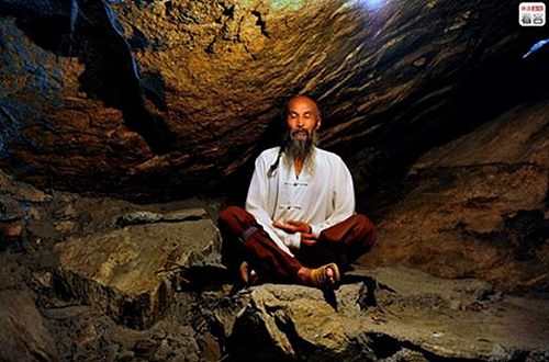 A Daoist meditating in a cave