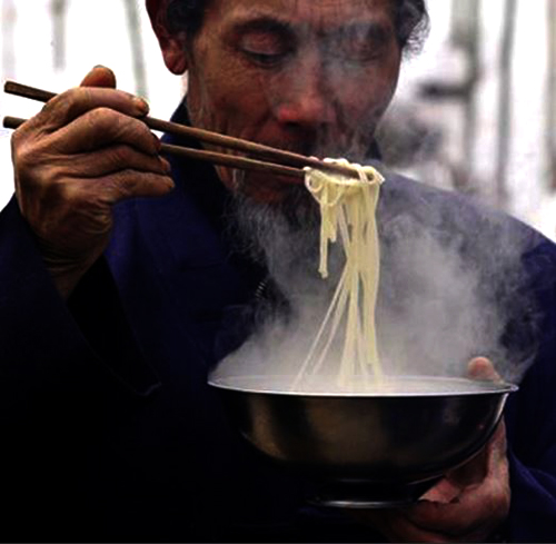 A Daoist enjoys his hand-made noodle