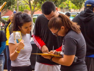 One of the 54 teams looking over their clues during the race. (Photo by Luis Solis)