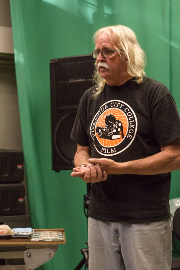 Jack McLean shares his experiences in the film industry and brags about his son in his Wednesday night Introduction to Lighting Design class.(Photo by Steven Smith)