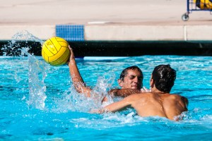 H20: During a scrimmage at the Riverside Aquatics Center, Riverside City College water polo player Joey Valdez (left) attempts a shot against teammate Chris Frazee.