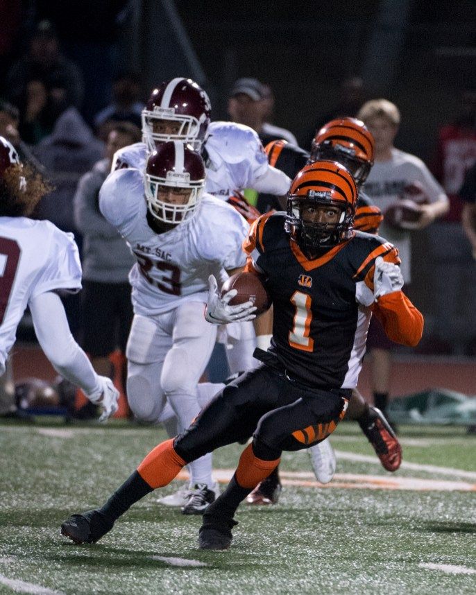 RUN: RCC's wide receiver Alejandro Marenco makes a desperate attempt to gain ground against Mt. SAC at the state semifinals held at RCC on Nov. 29, 2014. (Michael Walter   Asst. Photo Editor)