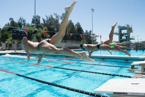 (Left to right) Riverside City College swimmers Justin Rohn, Daniel Ghomi, and Garret Shimko prepare for the CCCAA Championships at East Los Angeles College.